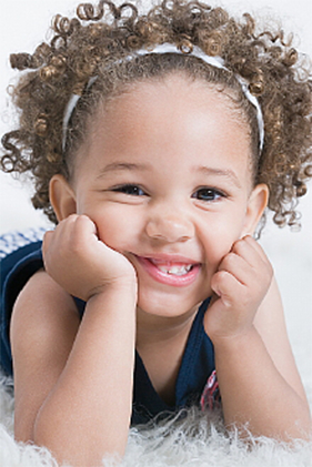 Black, Curly Haired Girl at the Pediatric Dentist serving Pearland, Houston, Alvin, Rosharon and Lake Jackson, TX